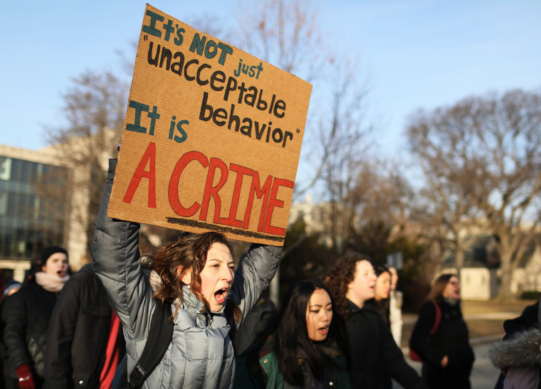 Image: A demonstration supporting rape survivors at Northwestern University in Evanston, Ill.