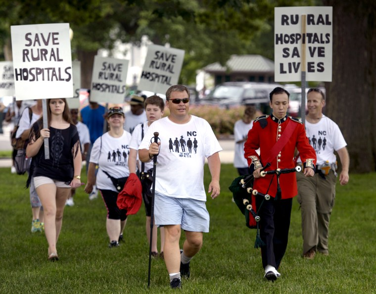 Mayor Adam O'Neal, of Belhaven, North Carolina, walks with supporters during a rally for rural hospitals on Capitol Hill June 15, 2015 in Washington, DC.