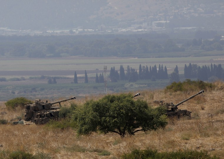 Israeli army fires into Lebanon after military targets hit by missiles