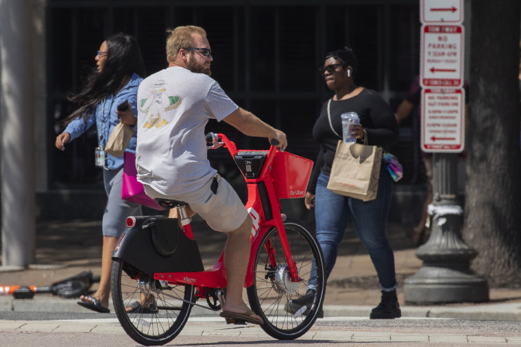 A visitor pedals a bike powered by both pedals and battery-driven small motors in downtown Washington on Friday. Motorized electric bicycles may soon be humming their way into serene national parks and other public lands nationwide, under a new Trump administration order.