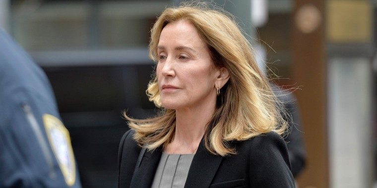 Felicity Huffman reports to prison for 14-day sentence in admissions scandal