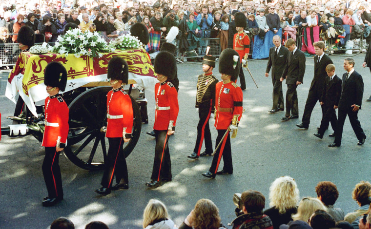 Image: Guardsmen escort the coffin of Diana, Princess of Wales draped in the Royal Standard, as the cortege passes through crowds gathered along Whitehall