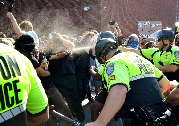Image: Police use pepper spray on anti-parade demonstrators during the Straight Pride parade in Boston on Aug. 31, 2019.