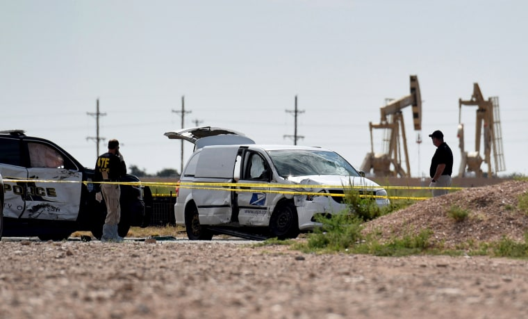 Image: Officials investigate a stolen mail truck used by Seth Ator during a shooting in Odessa, Texas, on Sept. 1, 2019.