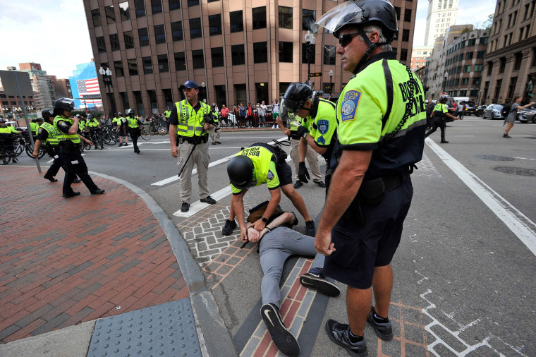 """Image: Boston Police officers arrest a counterprotester during the \""""Straight Pride\"""" parade"""