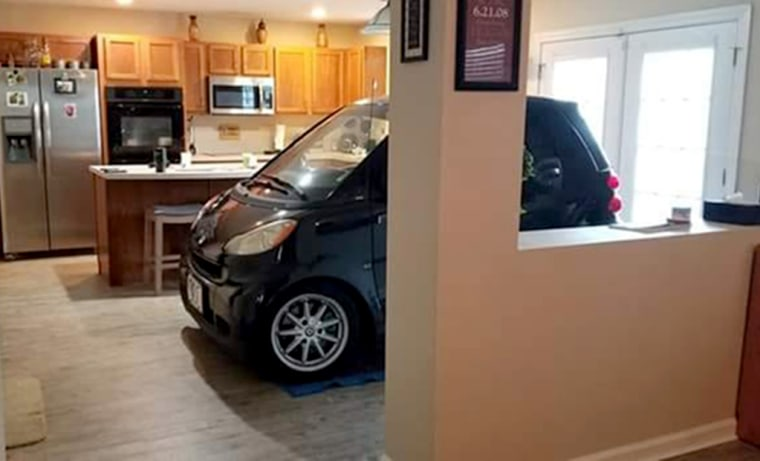 Image: Patrick Eldridge parked his Smart Car in his Florida home because he was afraid Hurricane Dorian would blow it away.