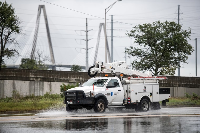 Image: A Dominion Power utility truck drives through water on the road following high tide Sept. 4, 2019 in Charleston, South Carolina.
