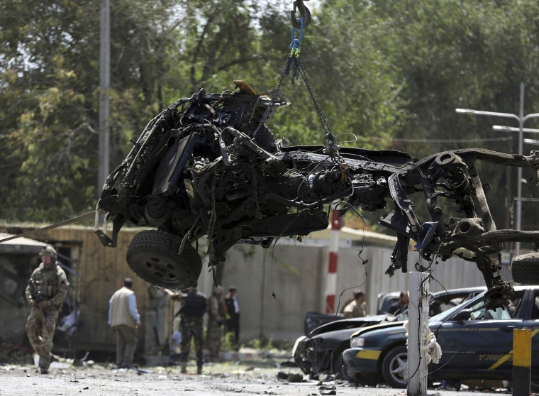 Image: Resolute Support (RS) forces remove a destroyed vehicle after a car bomb explosion in Kabul, Afghanistan