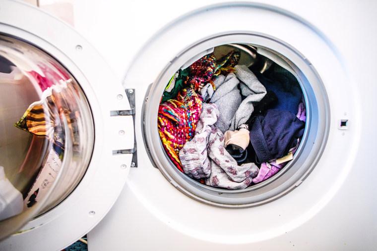 Image: laundry day.Washing machine full of colorful clothes