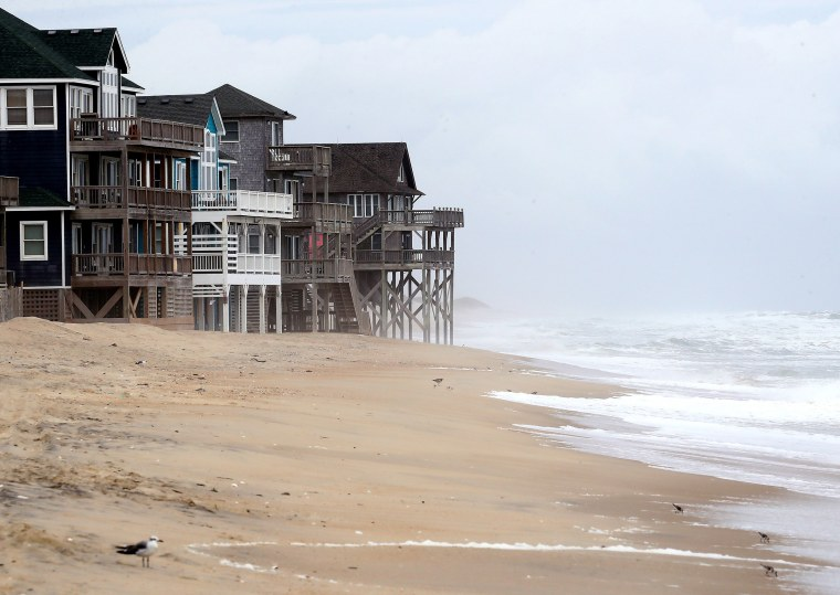 Image: Heavy surf caused by approaching Hurricane Dorian rolls in among beach houses