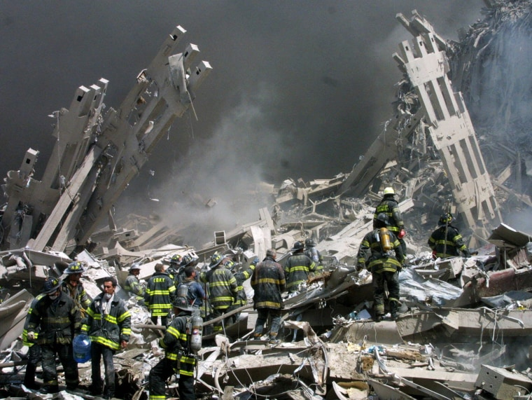 Firefighters make their way through the rubble at the World Trade Center in New York on Sept. 11, 2001.