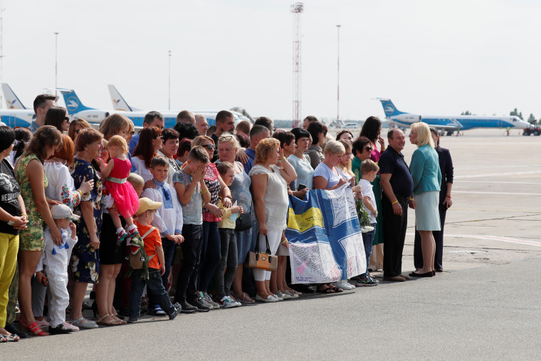 Relatives of Ukrainian prisoners wait to greet those freed at an airport in Kiev on Saturday.