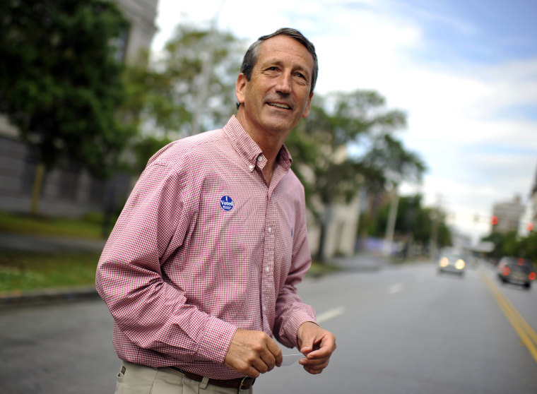 Image: Former Gov. Mark Sanford leaves a polling place in Charleston, S.C., in 2013.