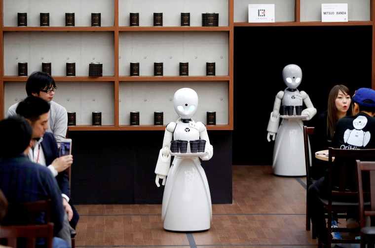 Image: FILE PHOTO: Remotely controlled robots OriHime-D serve customers at a cafe in Tokyo