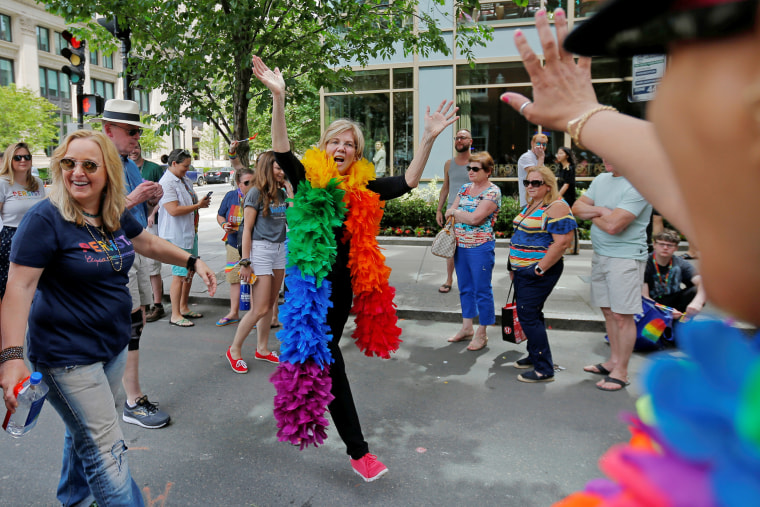 U.S. Senator Elizabeth Warren and musician Melissa Etheridge march in Boston's 48th Pride Parade in Boston