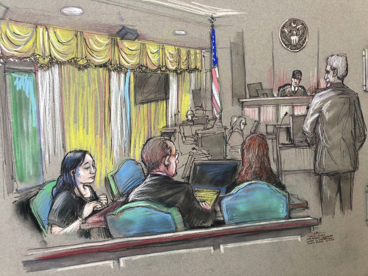 Yujing Zhang, left, a Chinese woman charged with lying to illegally enter President Donald Trump's Mar-a-Lago club, listens to a hearing before Magistrate Judge William Matthewman in West Palm Beach, Fla. on April 15, 2019.