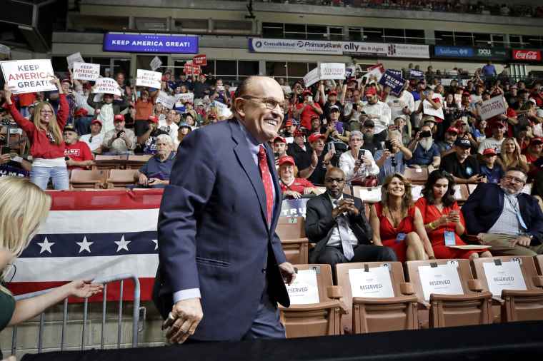 Image: Former New York City Mayor Rudy Giuliani smiles as he arrives to President Donald Trump's campaign rally on Aug. 15, 2019, in Manchester, N.H.