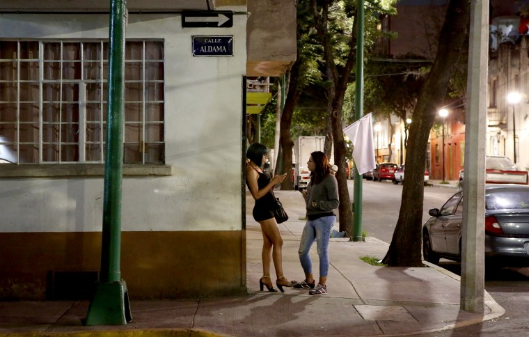 Image: Trans rights activist Kenya Cuevas speaks with Italia, a transgender sex worker, in Mexico City on Aug. 28, 2019.