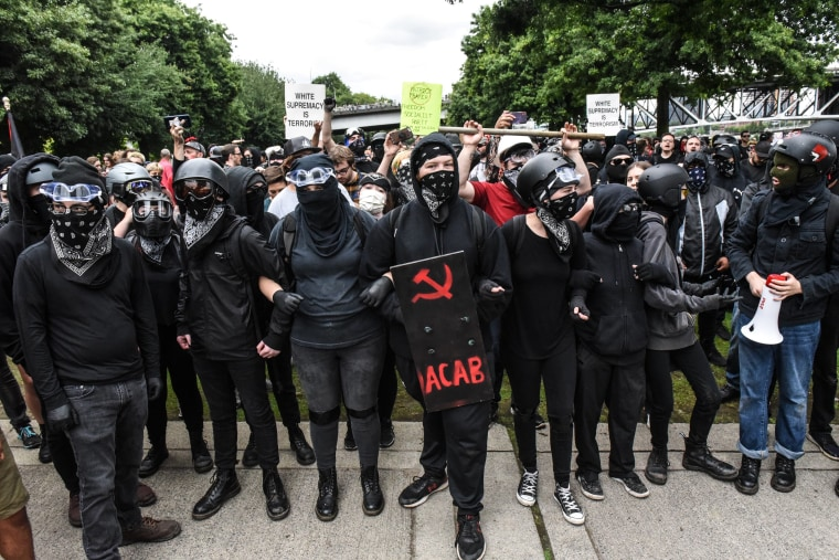 Image: Members of Antifa line up during an alt-right rally in Portland, Oregon