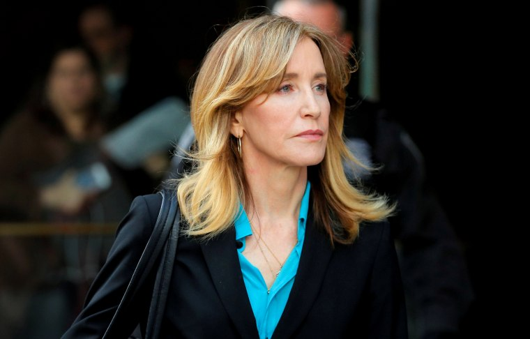 Image: Felicity Huffman leaves federal court in Boston on April 3, 2019. Huffman faces charges in a nationwide college admissions cheating scandal.
