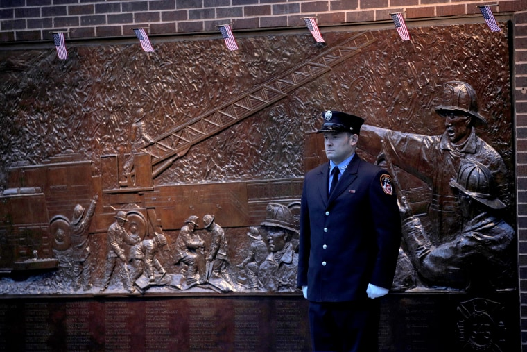 Image: Firefighter outside Firehouse Engine 10 and Ladder 10 on 18th anniversary of the September 11, 2001 attacks at the 911 Memorial in lower Manhattan in New York