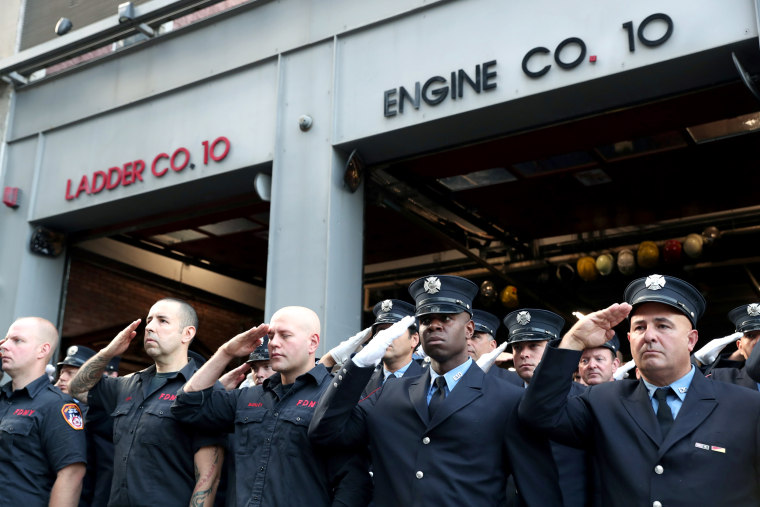 Image: Firefighters stand at attention on the 18th anniversary of the September 11, 2001 attacks in lower Manhattan in New York