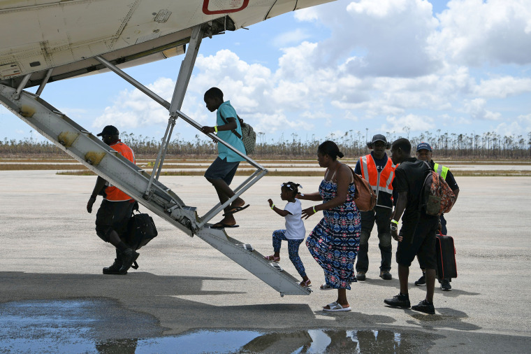Image: Abaco residents are evacuated from the island at the airport in the wake of Hurricane Dorian in Marsh Harbour
