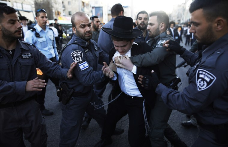 Image: Police detain ultra-Orthodox Jews during a protest against Israeli army conscription in Jerusalem