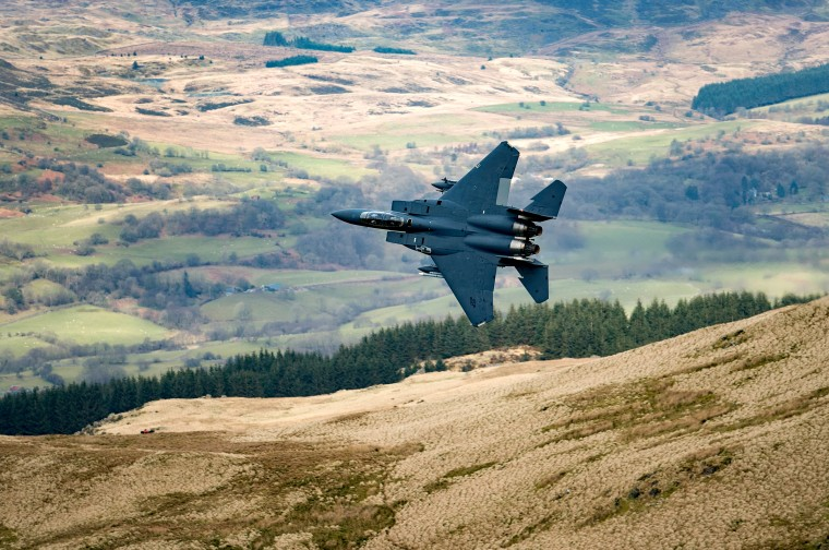 Image: A U.S. Air Force F-15 fighter jet based at RAF Lakenheath flies through Dolgellau, Wales, in 2018.