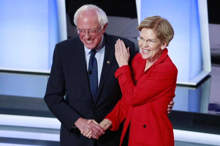 Image: U.S. Senators Sanders and Warren shake hands before the start of the first night of the second 2020 Democratic U.S. presidential debate in Detroit, Michigan, U.S.
