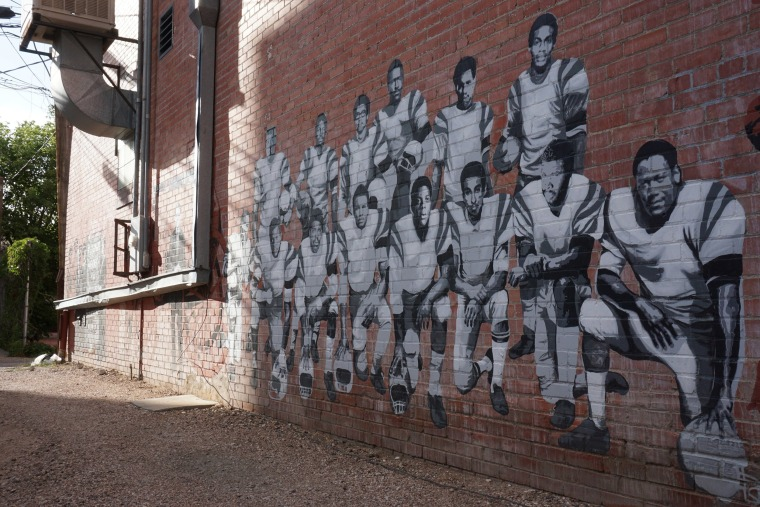 Image: Part of an alleyway mural in downtown Laramie, Wyo., that honors the Black 14