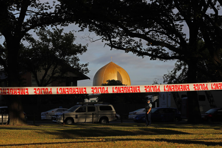 Image: A police officer stands guard in front of the Masjid Al Noor mosque in Christchurch, New Zealand,