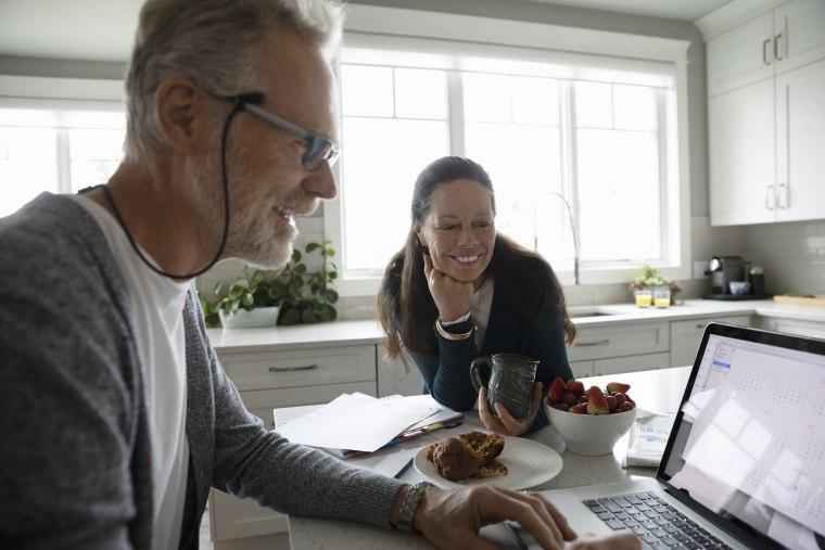 Image: Senior couple using laptop in kitchen