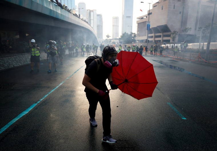 Image: An anti-government protester protects himself with an umbrella in Hong Kong on Sept. 15, 2019.