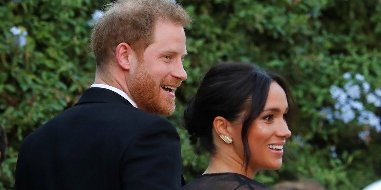 Meghan Markle attends designer Misha Nonoo's wedding wearing a sleek black dress