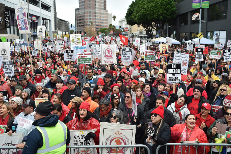 Image: Teachers and their supporters rally in downtown Los Angeles, California on the second day of the teachers strike