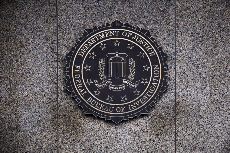 Image: The Federal Bureau of Investigation seal is displayed outside FBI headquarters in Washington on Feb. 2, 2018.