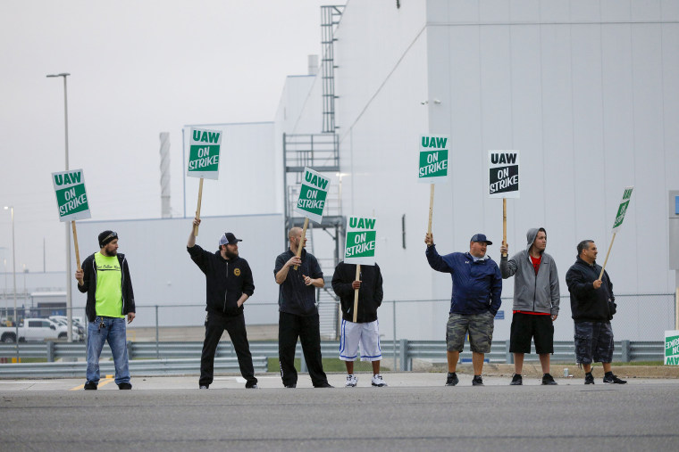 Image: United Auto Workers members picket at a gate at the General Motors Flint Assembly Plant after the UAW declared a national strike against GM at midnight on Sept. 16, 2019 in Flint, Michigan.
