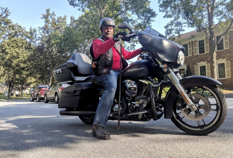 "Image: State Burner's Motorcycle Club Bowie chapter president Rodney ""Rhodes"" Yancey with his motorcycle, nicknamed ""Ghost,"" on Sept. 11, 2019."