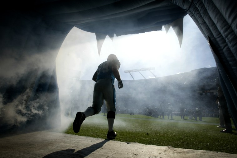 Image: A Carolina Panthers player takes the field in Charlotte, N.C., in 2004.
