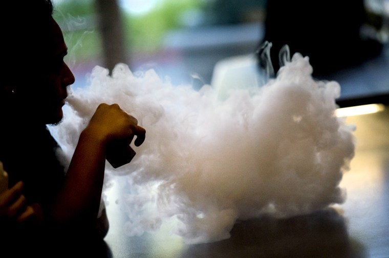Image: A customer vapes at a vaping store in Sacramento, Calif., on June 28, 2018.