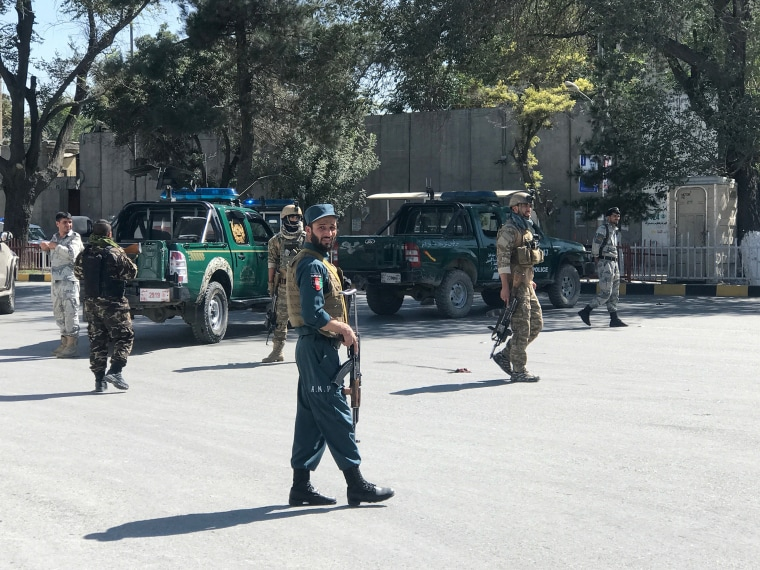 Image: Afghan security forces keep watch at the site of a blast in Kabul
