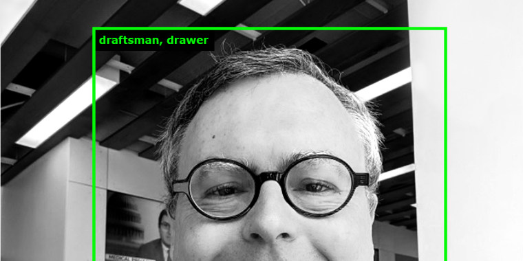 "The online art project ImageNet Roulette classified this image of NBC News reporter Alex Johnson as ""draftsman, drawer: an artist skilled at drawing,"" which couldn't be further from the truth."