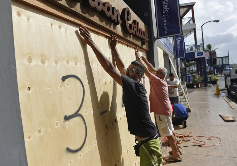 Image: People board up an Urban Cottage store in preparation for Hurricane Humberto in Hamilton, Bermuda