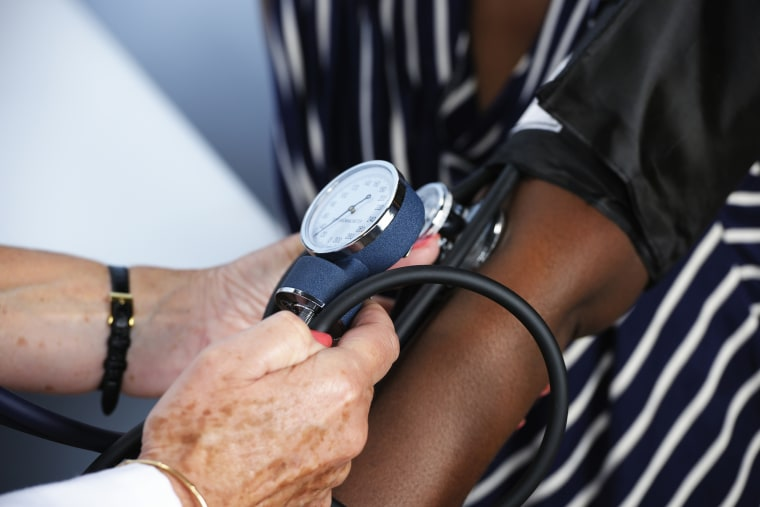 Image: Doctor Checking A Patient's Health
