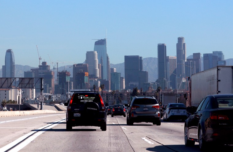 Image: FILE PHOTO: A highway carpool lane sits empty as traffic makes its way into Los Angeles