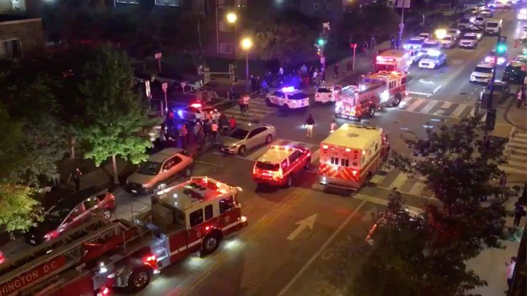 Image: Rescue vehicles are seen following a shooting in Washington