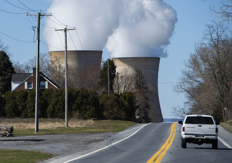A car drives past the nuclear plant on Three Mile Island in Middletown, Pennsylvania on March 26, 2019.