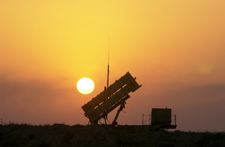 Patriot anti-missile missiles are aimed skyward at a base ne