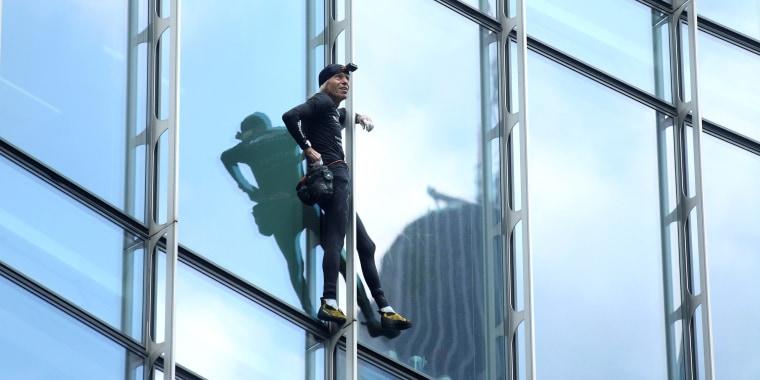 French urban climber Alain Robert climbs the Skyper building in Frankfurt